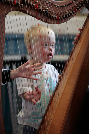 little boy music therapy with harp
